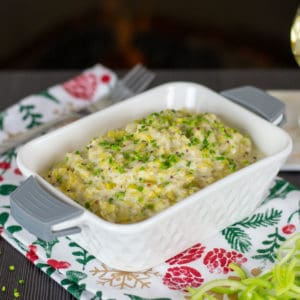 My Creamed Leeks recipe shot infant of a fireplace with a glass of white wine