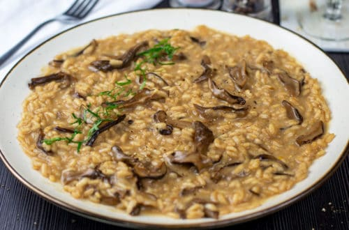A photo of my Wild Mushroom Risotto recipe garnished with flat parsley