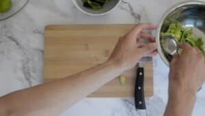 Scooping out the avocado stalk