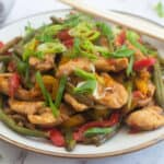 Keto Chicken stir fry garnished with spring onions and coriander
