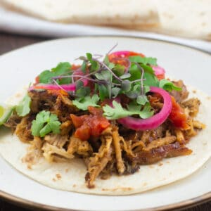 Tacos de Carnitas packed with different toppings