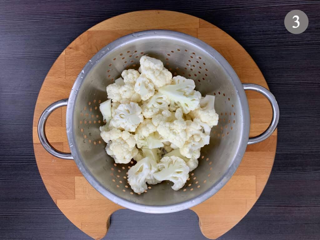 Washed cauliflower in a colander