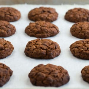 Baked vegan chocolate chip oatmeal cookies cooked on a baking tray