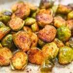 Brussels sprouts cooked and halved on a baking sheet