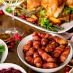crispy pigs and blankets on a decorated Christmas dinner table