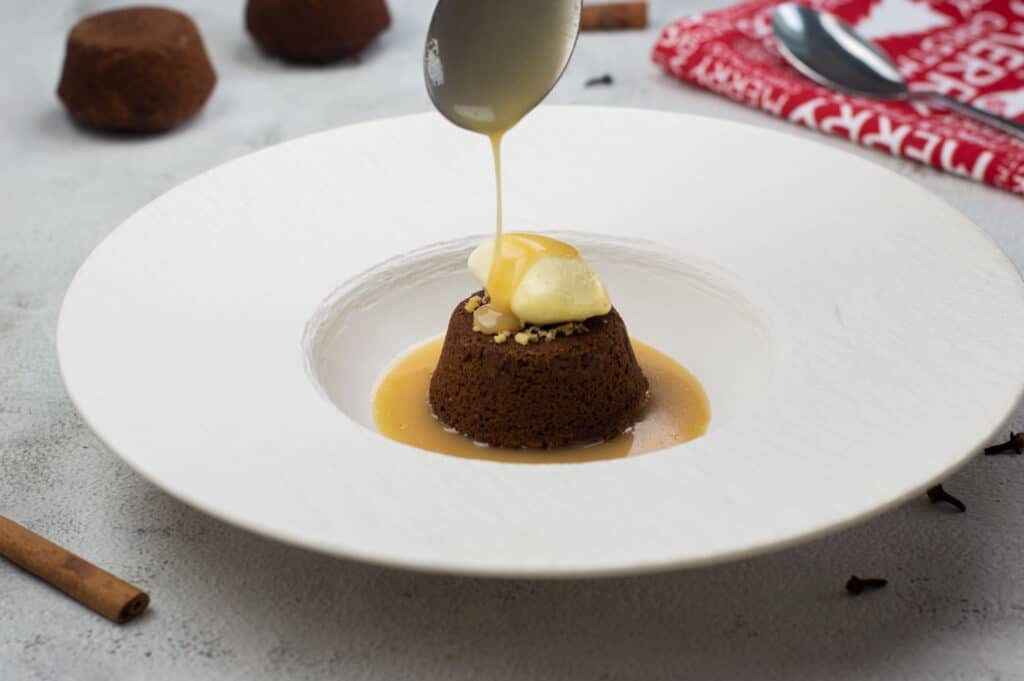 Sticky toffee pudding with spiced toffee sauce and ice cream
