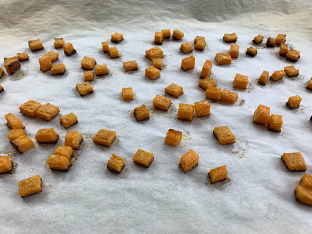 Roasted butternut squash on a baking tray