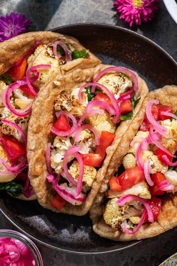 Roasted cauliflower tacos with pickled onions
