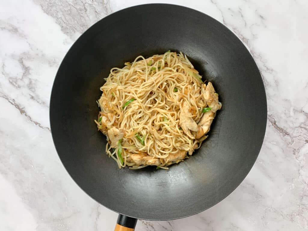 Stir fried chicken chow mein in a wok