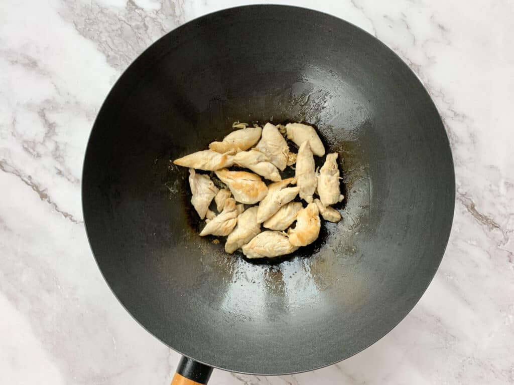 Cooked chicken in a large wok