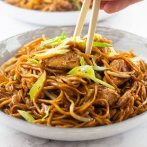 Chicken Chow Mein in a bowl with a pair of chop sticks