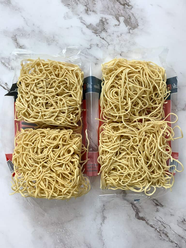 A open package of Shanghai Noodles with four portions