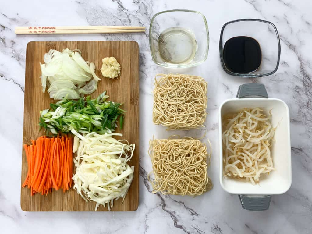 All the ingredients portioned for the vegetable chow mein recipes