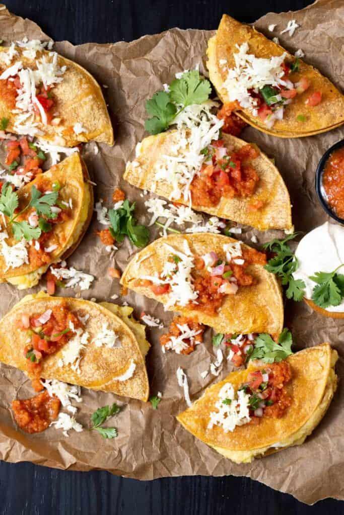 Crispy vegan tacos topped with fresh salsa