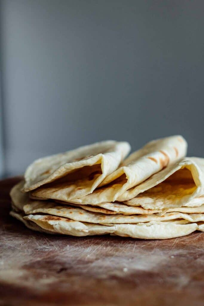 A pile of sourdough tortillas