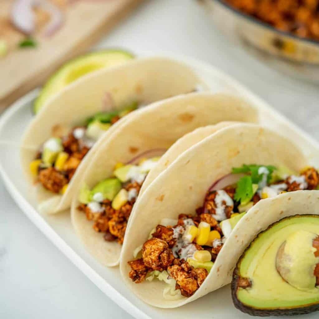 three tofu tacos with avocado