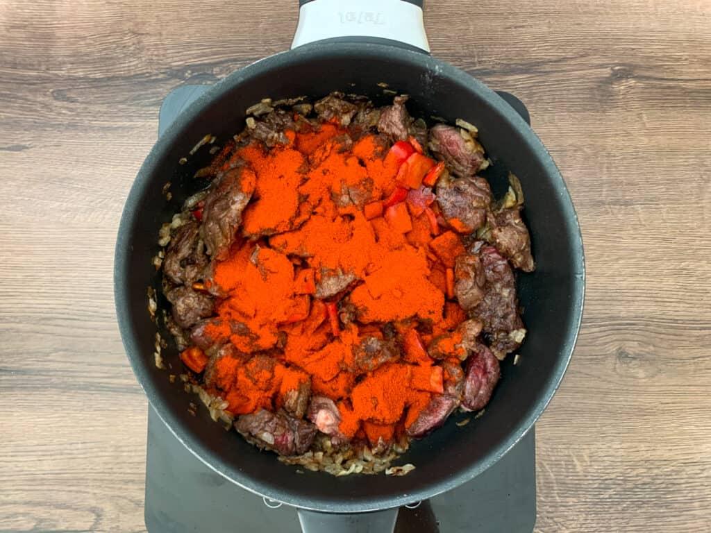 Adding lots of Hungarian paprika