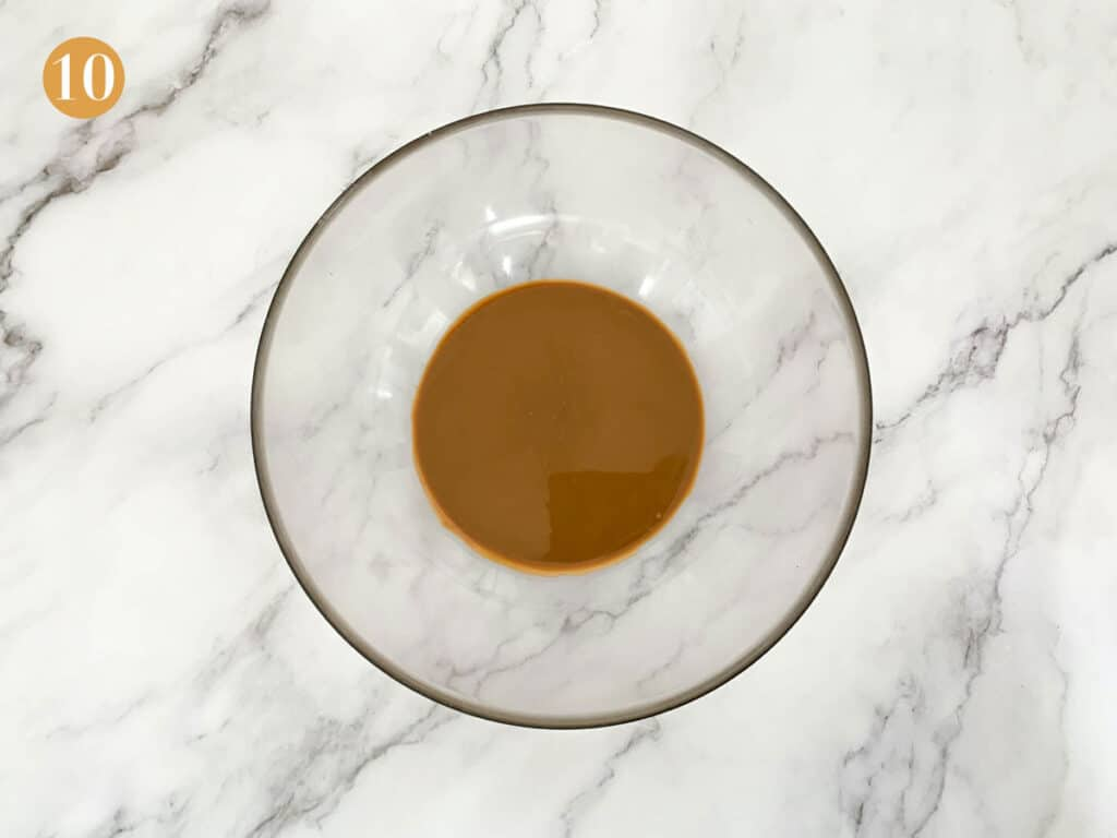 Melted biscoff spread in a glass bowl