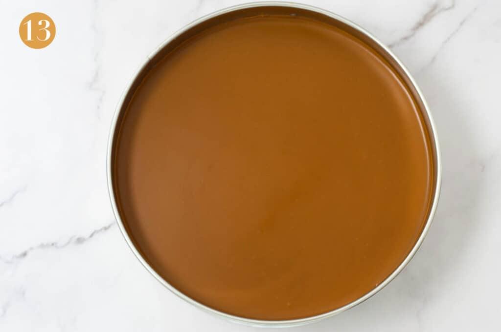 A set biscoff cheesecake in a cake tin