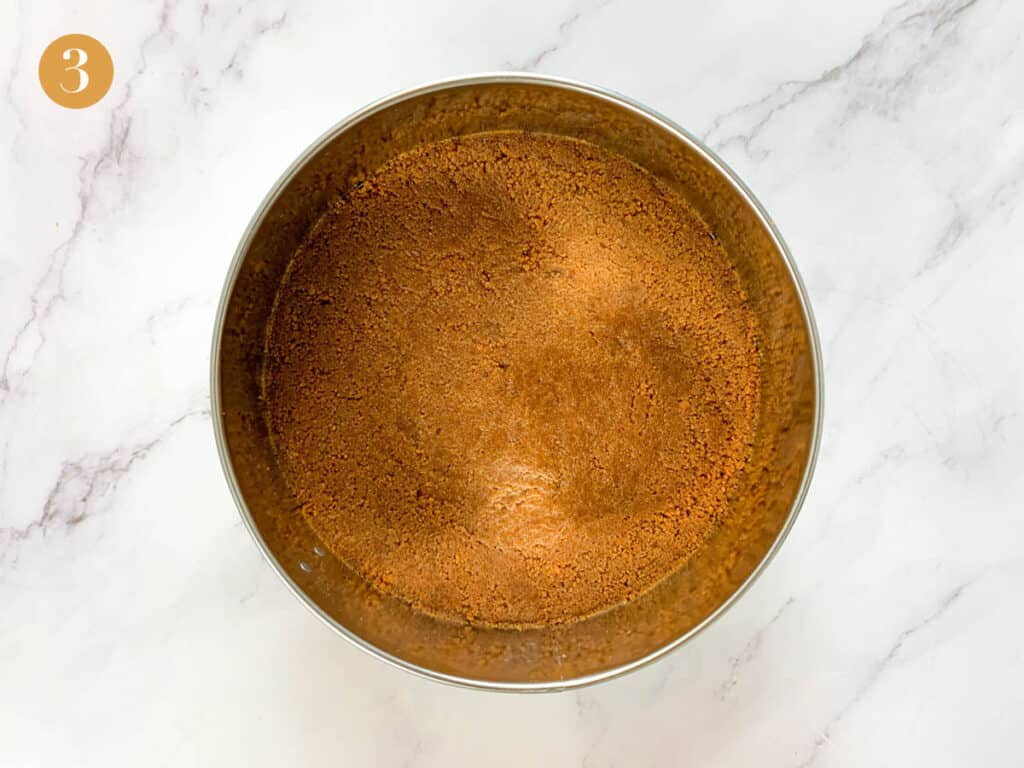 Even biscoff biscuit base in a cake tin