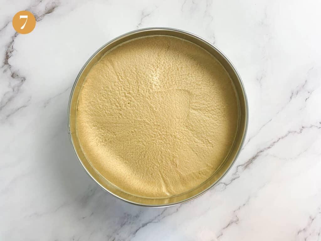 A smooth flat cheesecake in cake tin